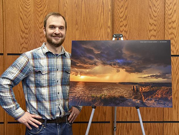 "Governor's Photo Contest Winner: ""Stormy Sunset"" and photographer Zachary Hargrove. The photo also won in the Scenery category and was chosen the Decade's Best."