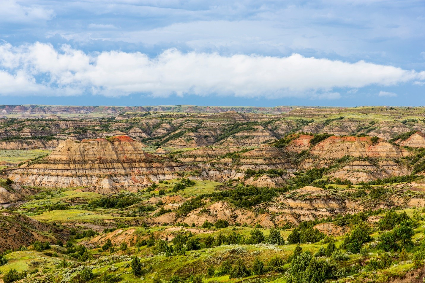 "The spectacular colors of the landscape give new meaning to ""Badlands."""