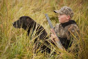 Young hunter and dog