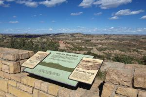 Interpretive panel in front of Painted Canyon scenic view