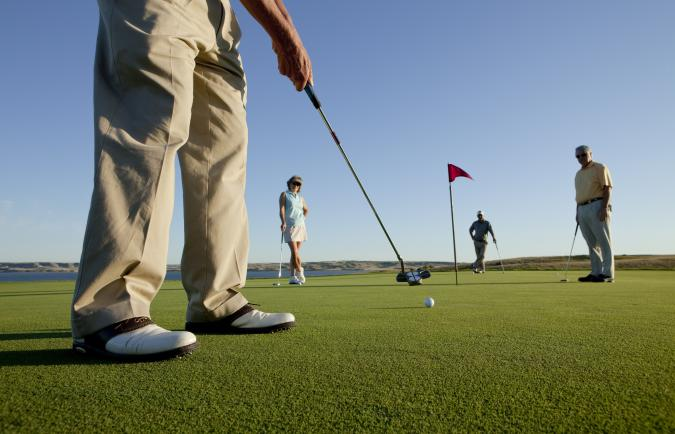 Golfers on putting green